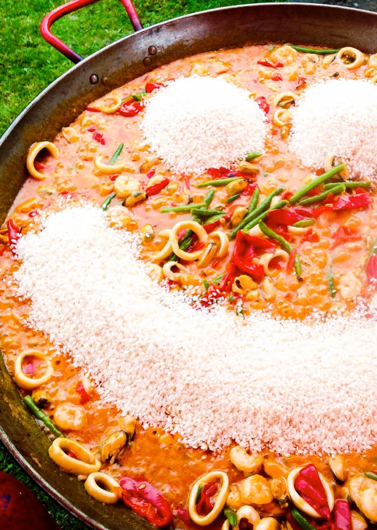image of a smiling paella